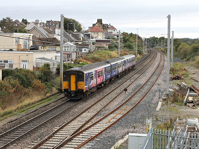 150225 brings up the rear of a southbound service, passing Hest Bank on the 4th October 2013