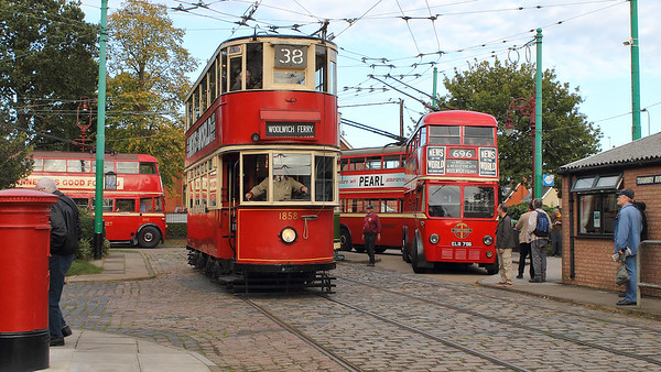 London Transport vehicles dominate this scene, with tram 1858 leaving and trolleys 796, 1201 & 260 waiting for custom at the terminus.