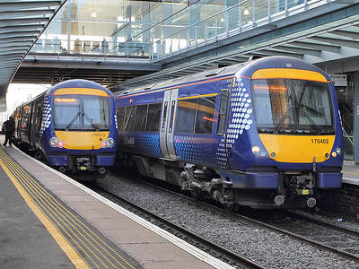Providing an illustration of contrasting headlight styles, 170402 & 170473 stand at Haymarket on the 15th October 2015