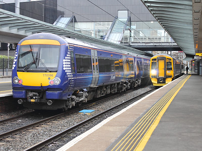 170396 stands at Haymarket with an east bound working, whilst 158740 waits for custom with a west bound one, on the 15th October 2015