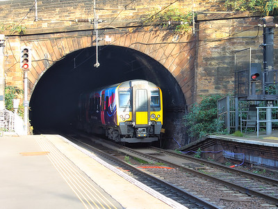 350405 finds sunlight as it exits Haymarket Tunnel on the 15th October 2015