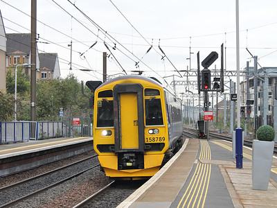A very clean looking 158789 arrives at Haymarket, with a train service from Glasgow Central, on the 15th October 2015