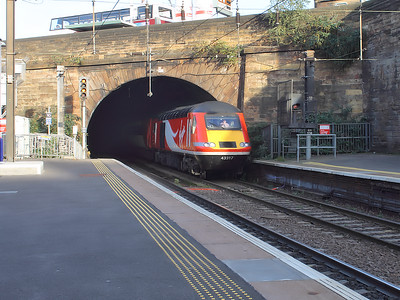 43317 leads it's Inverness bound Virgin Trains East Coast service into Haymarket on the 15th October 2015