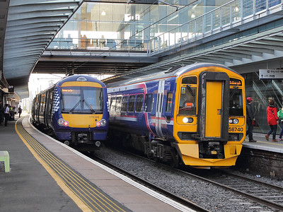 Back from wherever it was headed earlier, 158740 poses next to 170394 at Haymarket on the 15th October 2015