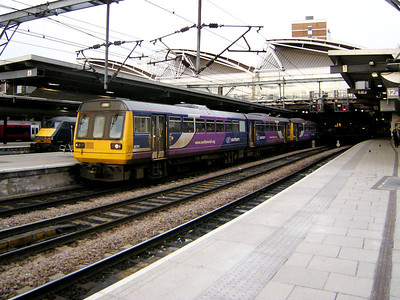 142095 stands, with 142048, at Leeds on the 15th March 2010