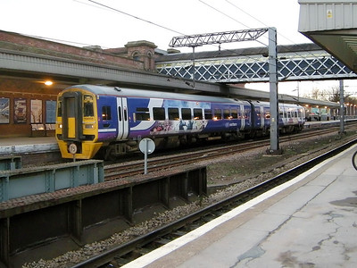 158905 pauses for custom at Wakefield Westgate on the 15th March 2010