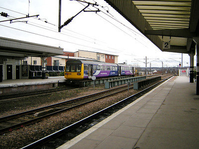 142015 hurries out of Wakefield Westgate on the 15th March 2010