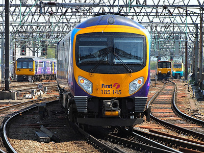 185145 hurries out of Manchester Piccadilly on the 22nd May 2012