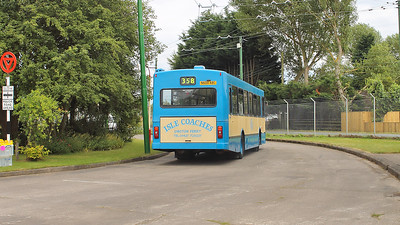 Heading out on a tour of Axim Island is this Isle Coaches bus on the 31st July