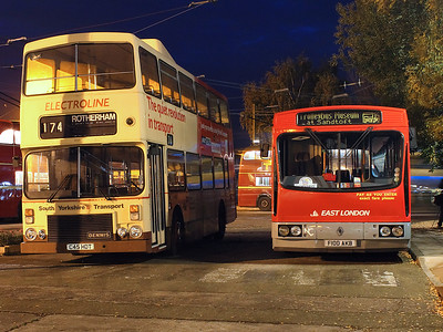 South Yorkshire PTE 2450 and East London RN100 bask in a glow of streetlights, as the last rays of daylight fade from the cloudy sky above