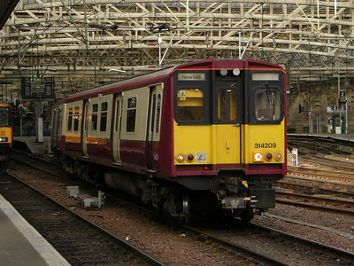 314209 leaves Glasgow Central on the 19th October 2010