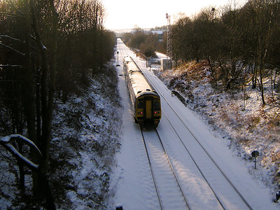 158754 rushes through the site of Wyke & Norwood Green station on the 23rd December 2009