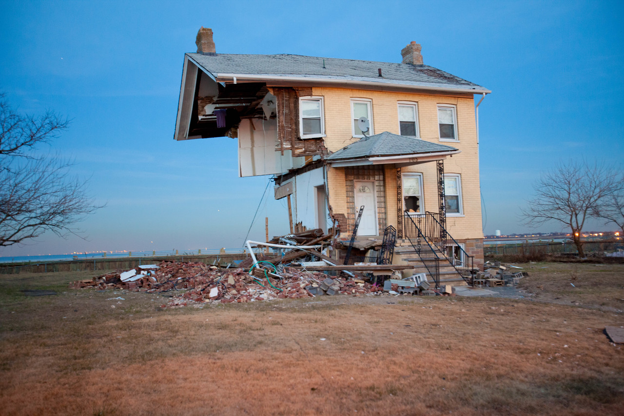 150 year old home in Union Beach, NJ cut in half by Hurricane Sandy. Corporation for National and Community Service Photo.
