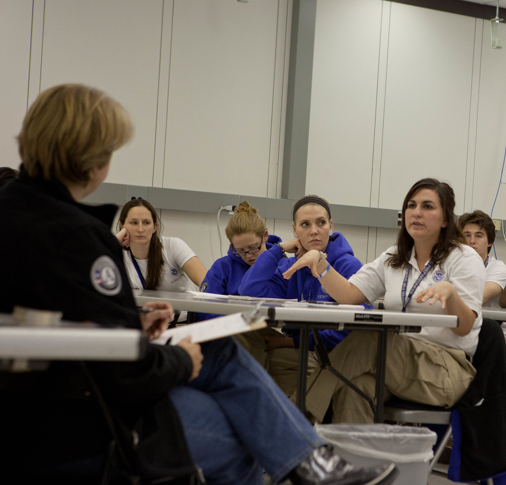 CNCS CEO Wendy Spencer listens to a FEMA Corps member during a discussion at the JFO in Lincroft, NJ. Corporation for National and Community Service Photo.