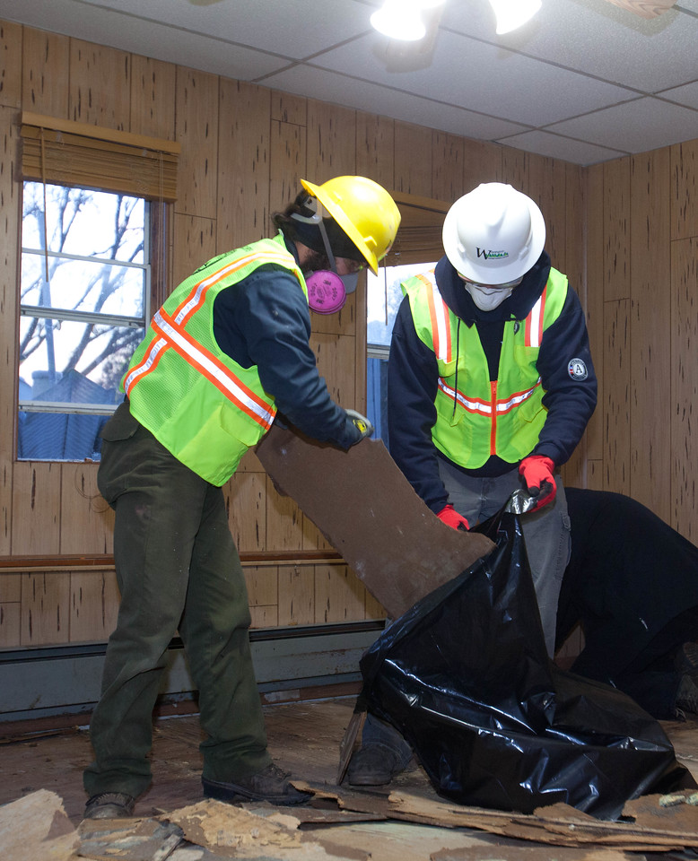 AmeriCorps members from the Washington Conservation Corps and AmeriCorps St. Louis removing debris from a home Union Beach, NJ. Corporation for National and Community Service Photo.