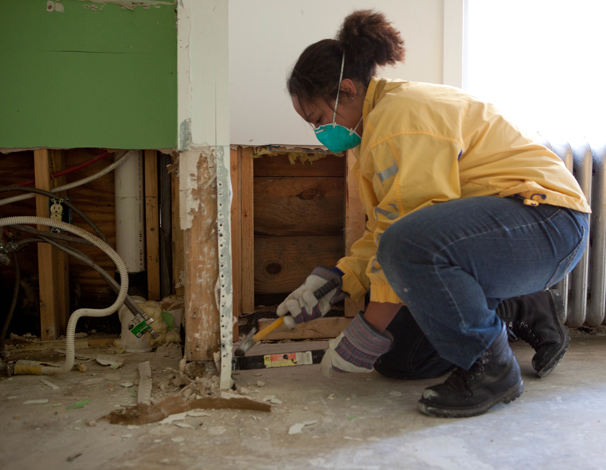 AmeriCorps member removing dry wall in a home in Atlantic City, NJ. Corporation for National and Community Service Photo.