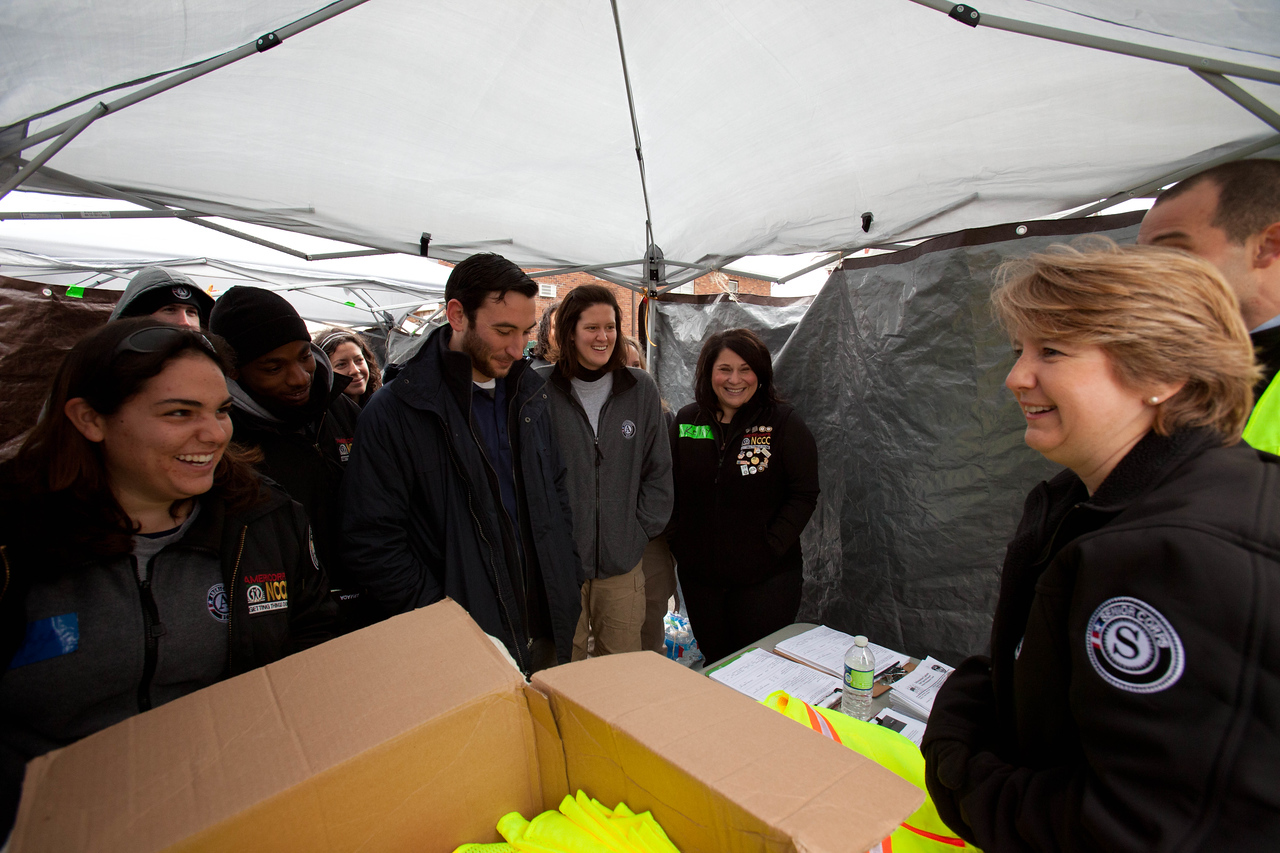 CNCS CEO Wendy Spencer speaks with AmeriCorps members working at the Volunteer reception center - Forward Operating Base (FOB Hope), Far Rockaway, NY. Corporation for National and Community Service Photo.
