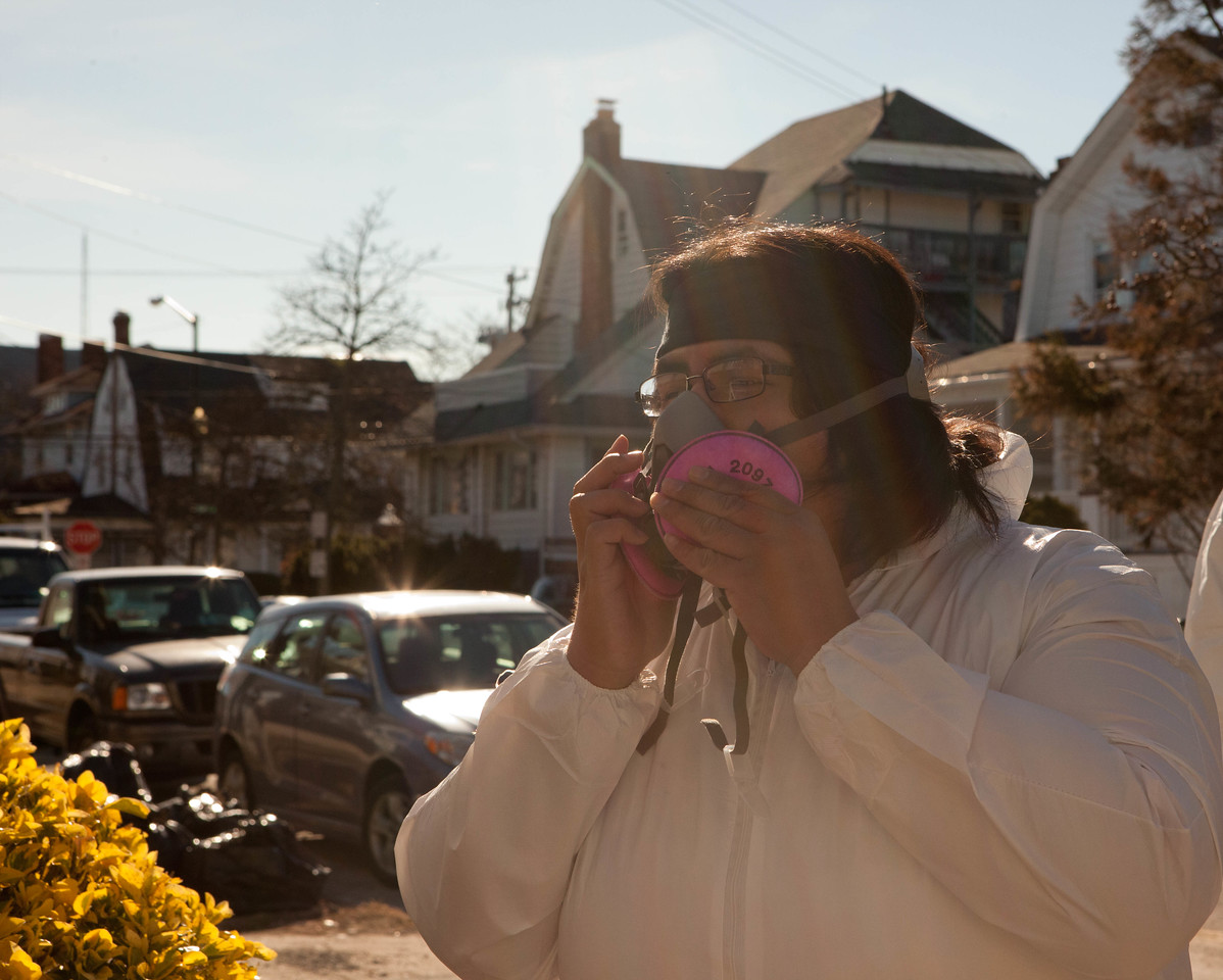 AmeriCorps member adjusting a breathing mask before entering a home affected by Hurricane Sandy in Atlantic City, NJ. Corporation for National and Community Service Photo.