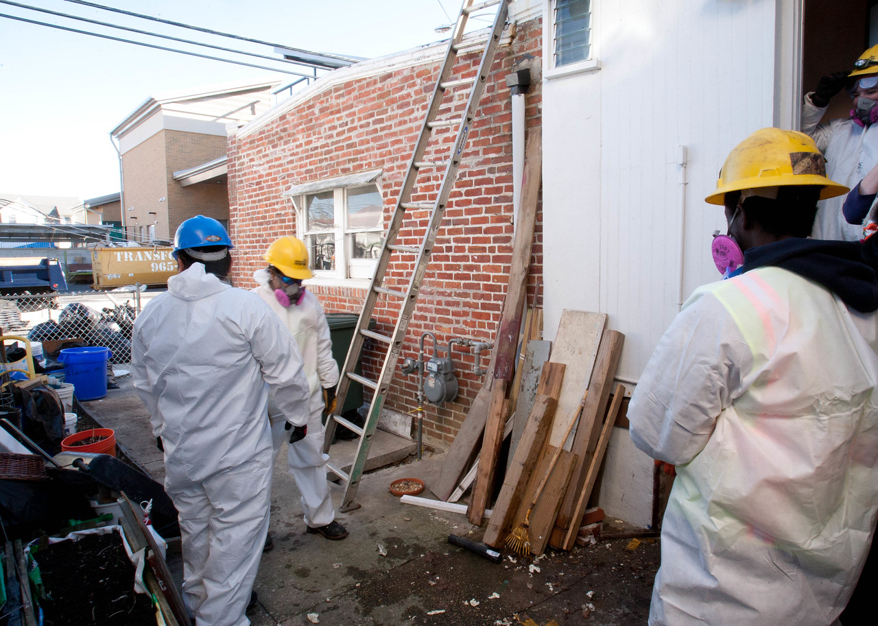 AmeriCorps members remove remove debris from a house in the Chelsea Heights neighborhood of Atlantic City, NJ that was affected by Hurricane Sandy. Corporation for National and Community Service Photo.