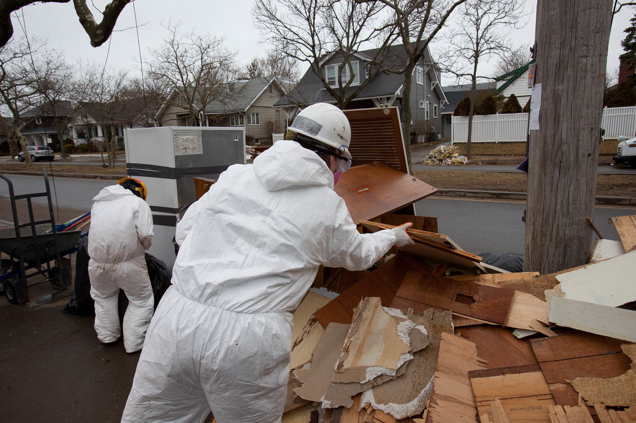 AmeriCorps members removing debris from a home in Belle Harbor, NY. Corporation for National and Community Service Photo.