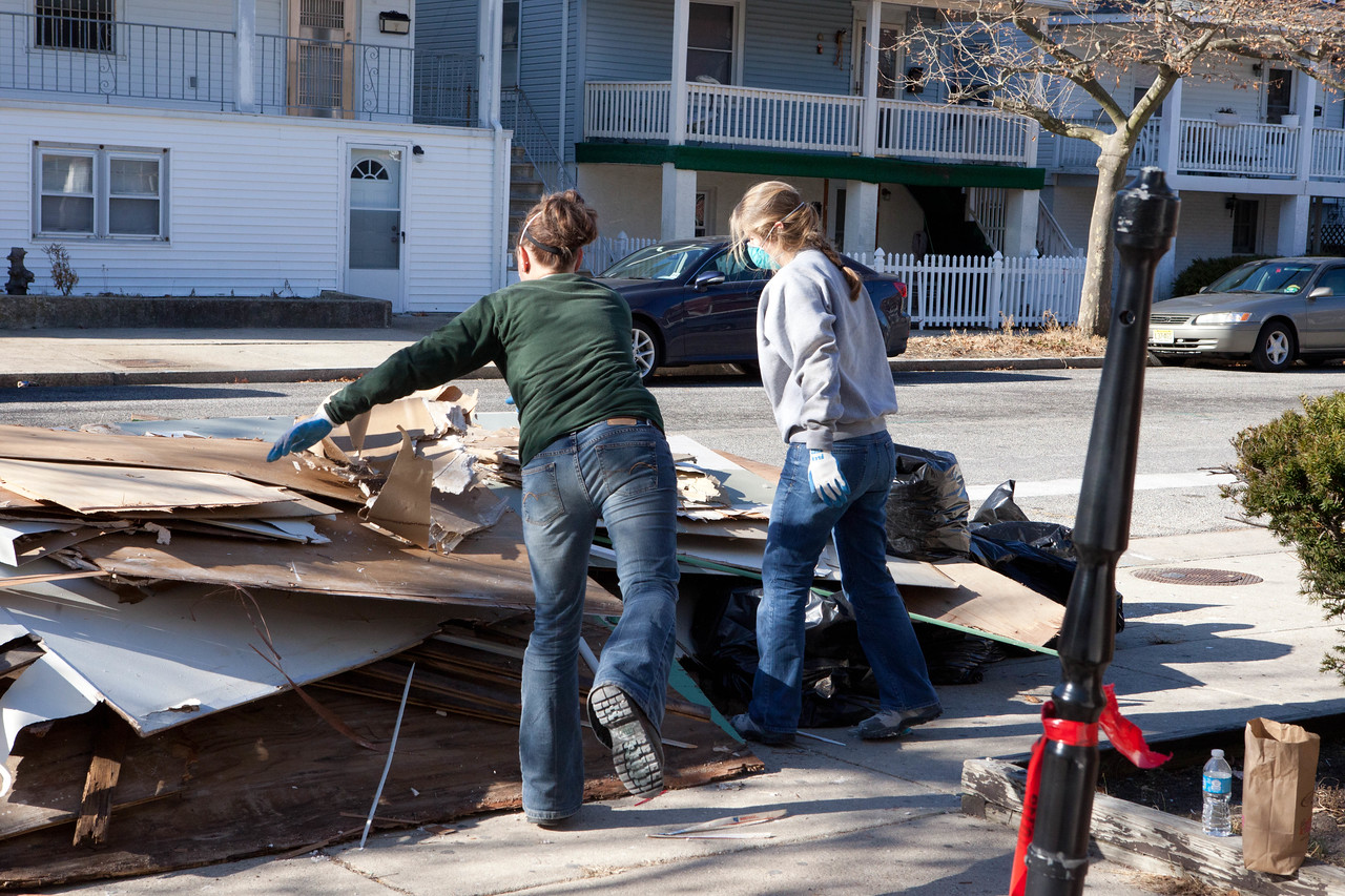 AmeriCorps NCCC members removing debris in a home in Atlantic City, NJ. Corporation for National and Community Service Photo.
