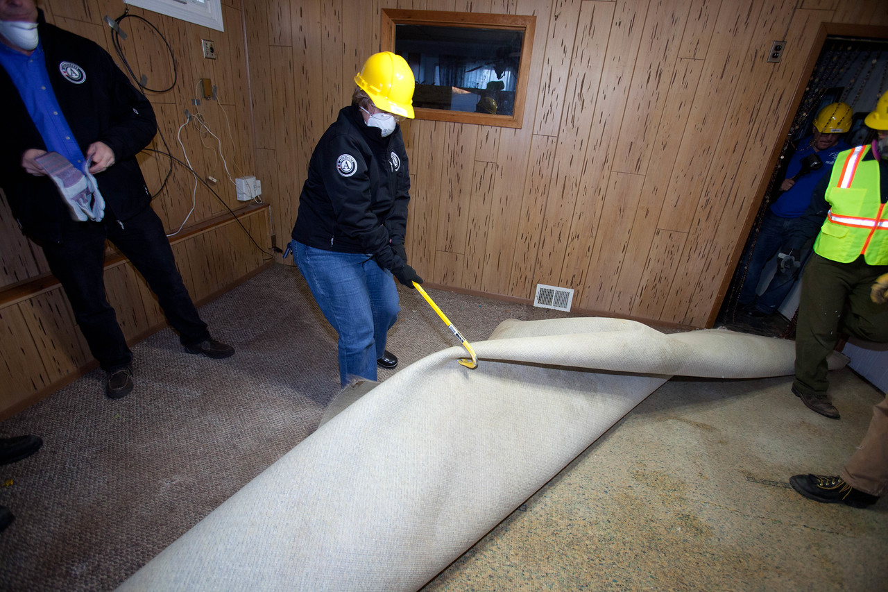 Washington Conservation Corps member and CNCS CEO Wendy Spencer removing damaged carpet from a home in Union Beach, NJ. Corporation for National and Community Service Photo.
