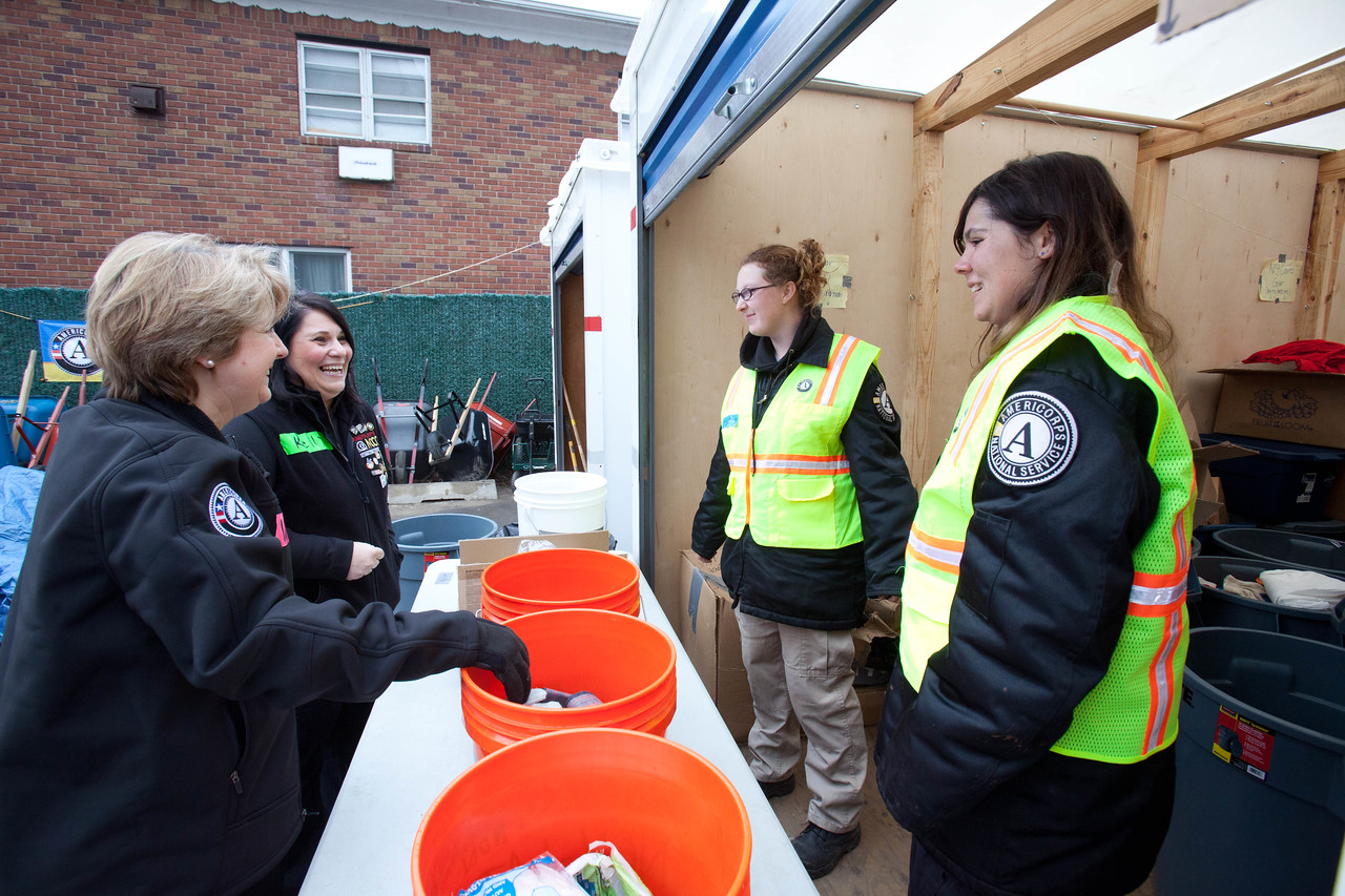 Senior Advisor for Disaster Services, Kelly DeGraff and CNCS CEO Wendy Spencer speak with AmeriCorps members serving at the volunteer reception center - FOB Hope, Far Rockaway, NY.  Corporation for National and Community Service Photo.