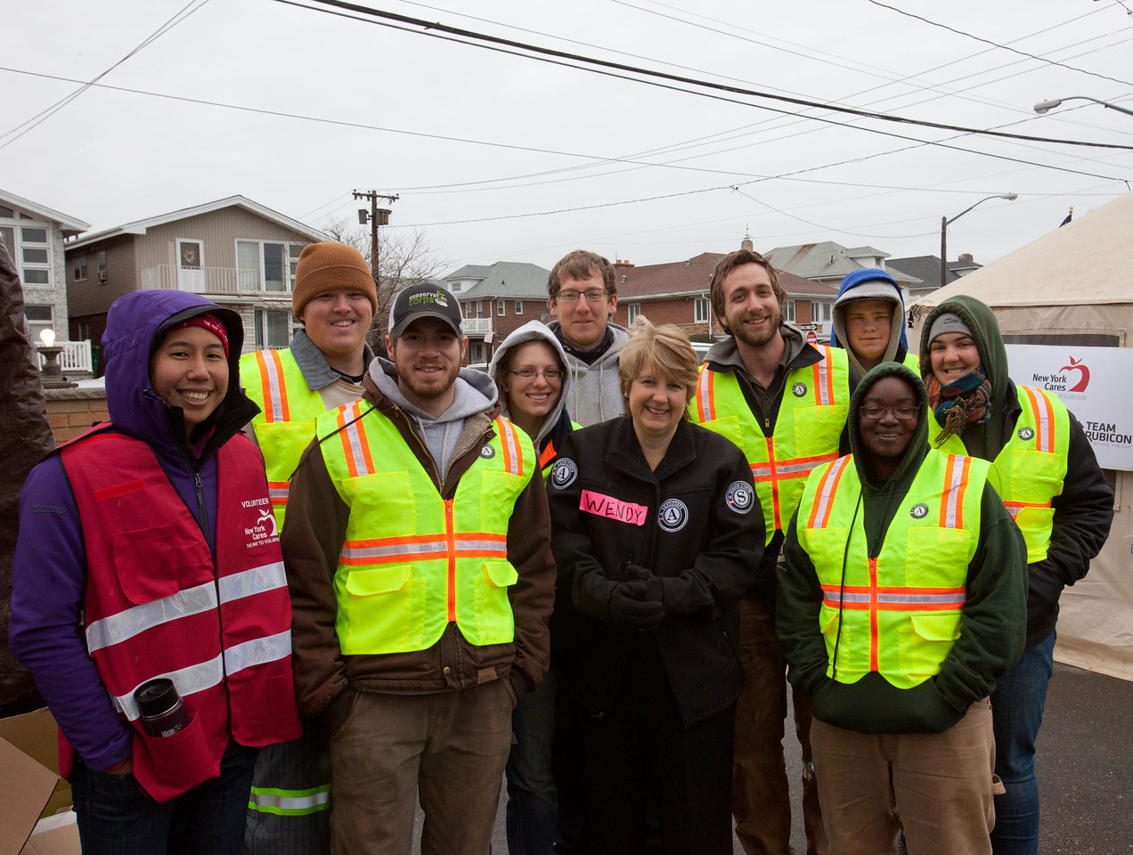 CNCS CEO, Wendy Spencer poses with New York Cares and AmeriCorps members at the FOB Hope in Far Rockaway, NY. Corporation for National and Community Service Photo.
