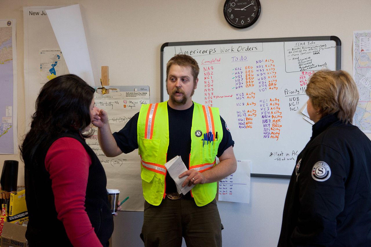 Washington Conservation Corps Crew Leader Ernest Farmer explains Hurricane Sandy clean-up locations and strategy to CNCS Senior Advisor for Disaster Services Kelly DeGraff and CNCS CEO Wendy Spencer at the VRC in Brigantine, NJ. (Corporation for National and Community Service photo)