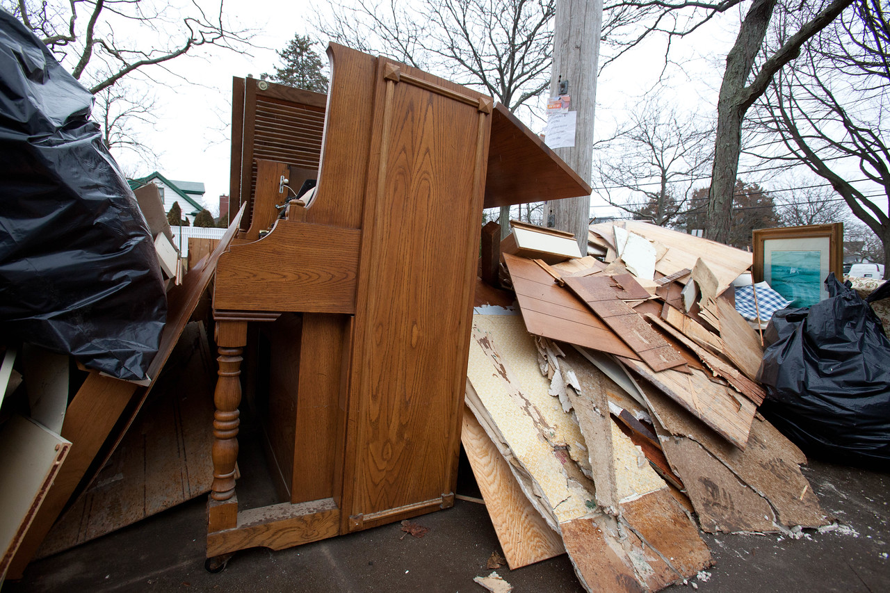 Debris in front of a home damaged by Hurricane Sandy in Belle Harbor, NY. Corporation for National and Community Service Photo.