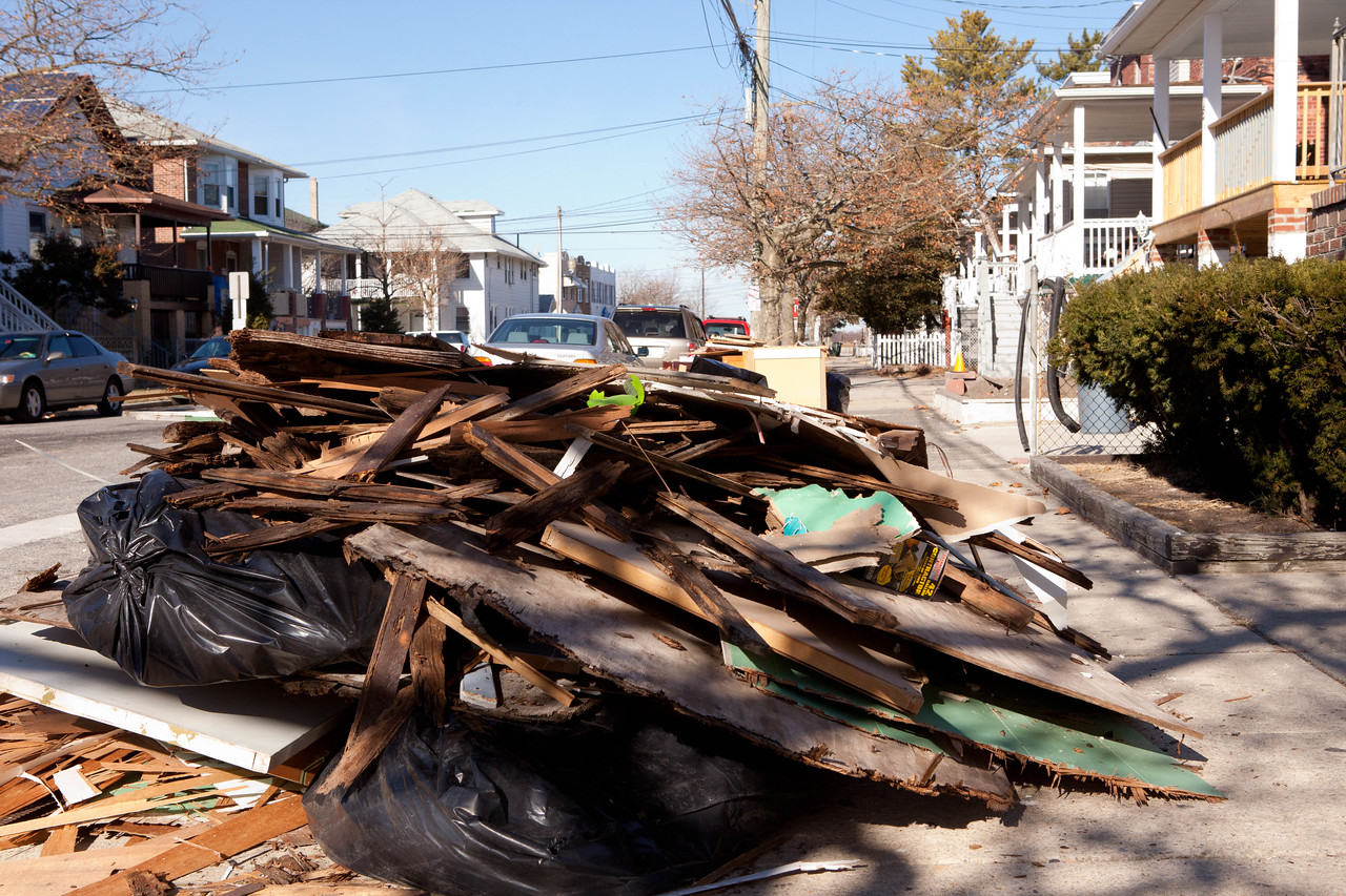 Debris in front of a home being cleaned out by AmeriCorps members in Atlantic City, NJ. Corporation for National and Community Service Photo.