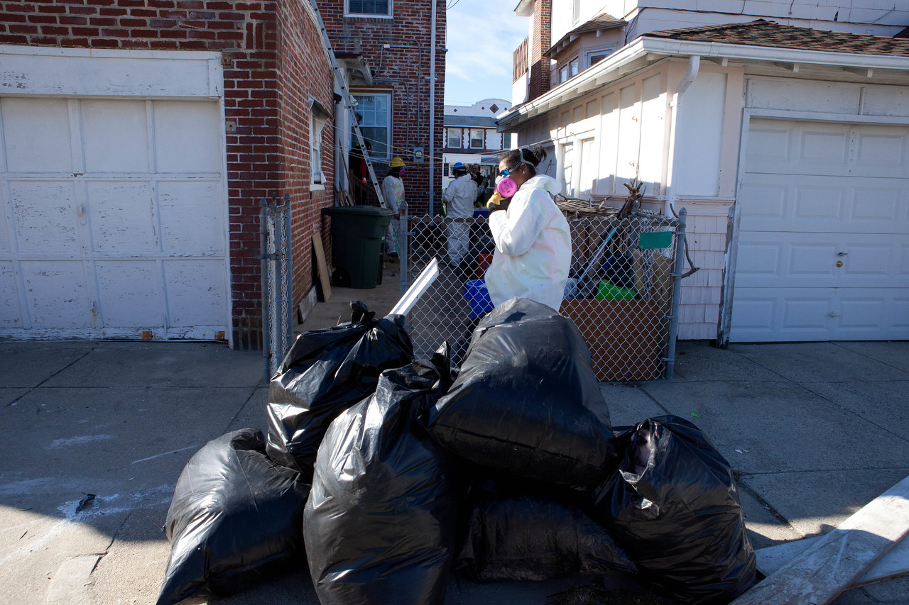 AmeriCorps members removing debris from a home in Atlantic City, NJ. Corporation for National and Community Service Photo.
