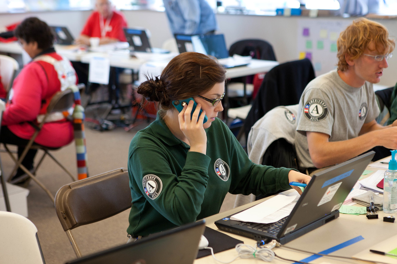 AmeriCorps NCCC members answer phones at the American Red Cross headquarters in North Brunswick Township, NJ, during the recovery effort for Hurricane Sandy in November 2012. (Corporation for National and Community Service photo)