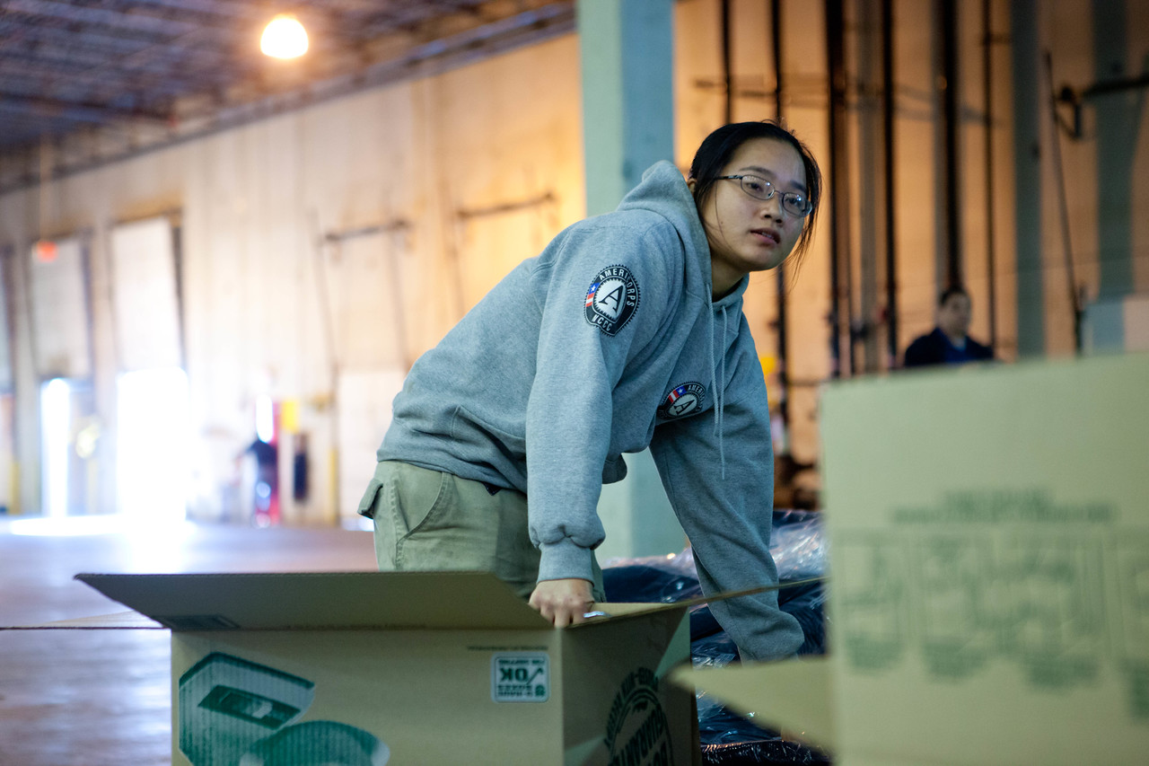 AmeriCorps member working at the supply distribution center in Somerset, NJ. Corporation for National and Community Service Photo.
