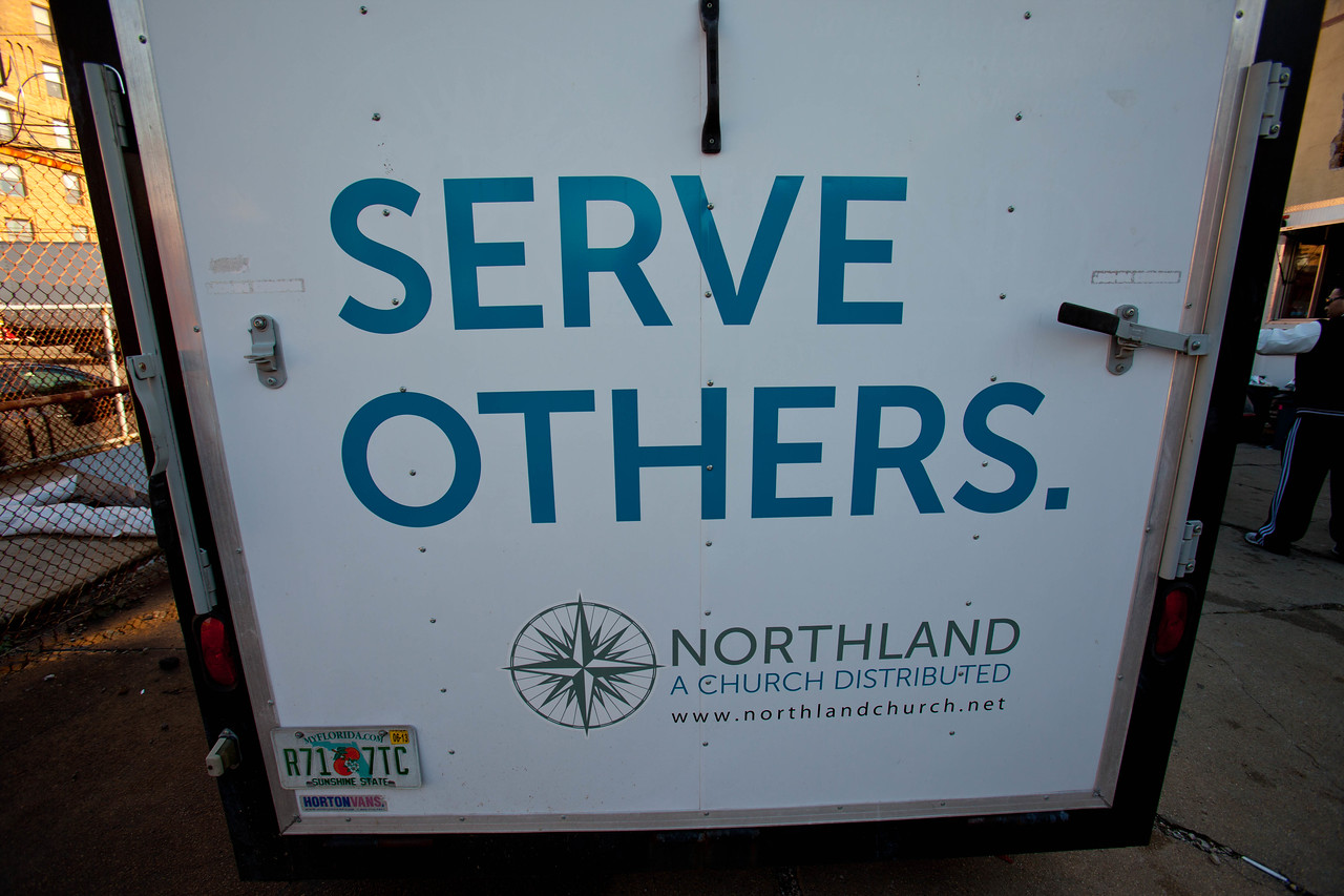 The slogan Serve Others on rear door of a truck sums up the theme of the day for many working in the Hurricane Sandy relief effort. (Corporation for National and Community Service photo)