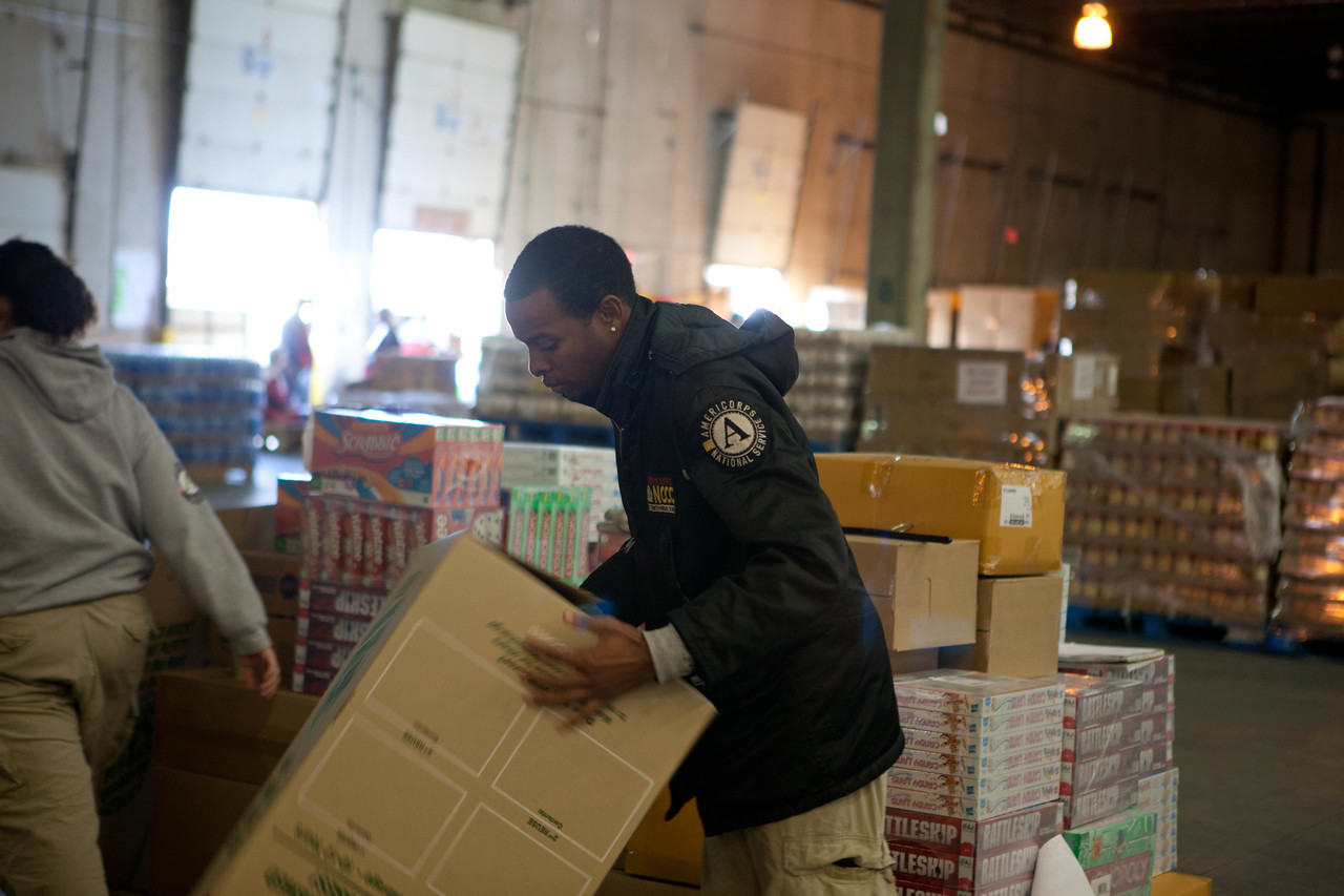 An AmeriCorps member prepares a shipping box at the supply distribution center in Somerset, NJ. (Corporation for National and Community Service photo)