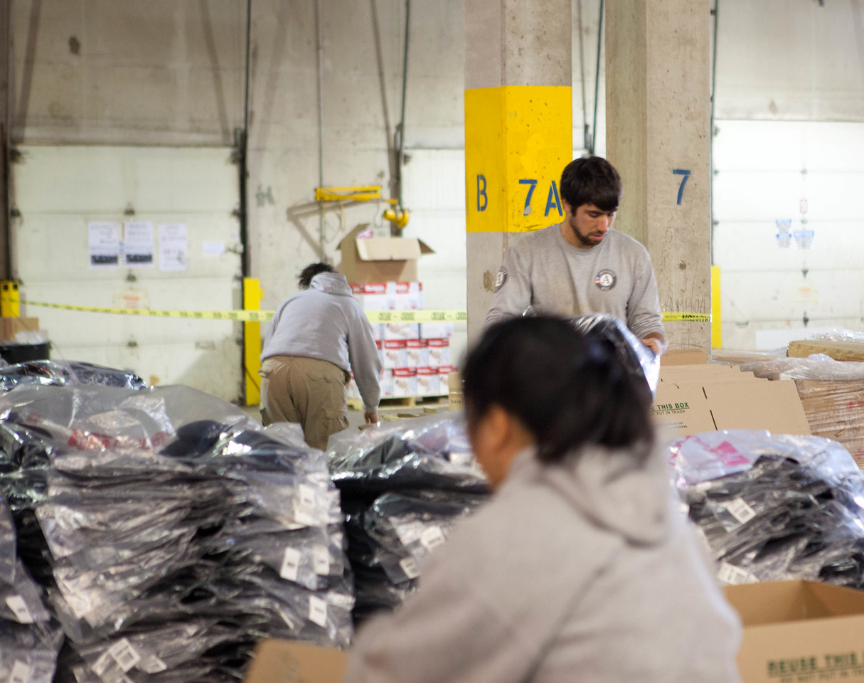 AmeriCorps members packing winter coats for hurricane survivors at the supply distribution center in Somerset, NJ.Corporation for National and Community Service Photo.