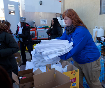 A FEMA Corps member prepares blankets for distribution to Hurricane Sandy survivors in Far Rockaway, NY during the response to Hurricane Sandy in November 2012. (Corporation for National and Community Service photo)