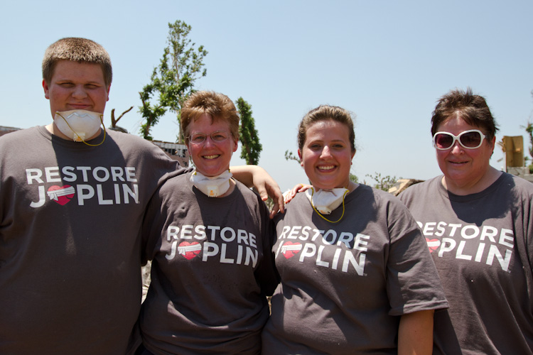 Libby Turner, the Federal Coordinating Officer for FEMA poses with family after working in the debris field in Joplin, MO. (Photo by Scott Julian, 2011).