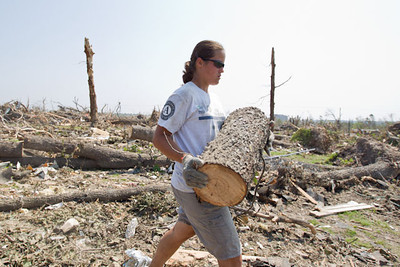 An AmeriCorps member hauls debris in Joplin, MO. (Photo by Scott Julian, 2011)