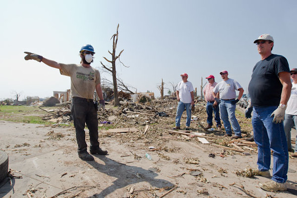 An Iowa Conservation Corps AmeriCorps member directs volunteers in Joplin, MO. (Photo by Scott Julian, 2011)
