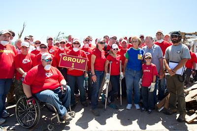 Kansas City Chief Players, employees, and family members, pose with AmeriCorps members after a long day of volunteering in Joplin, MO. (Photo by Scott Julian, 2011)
