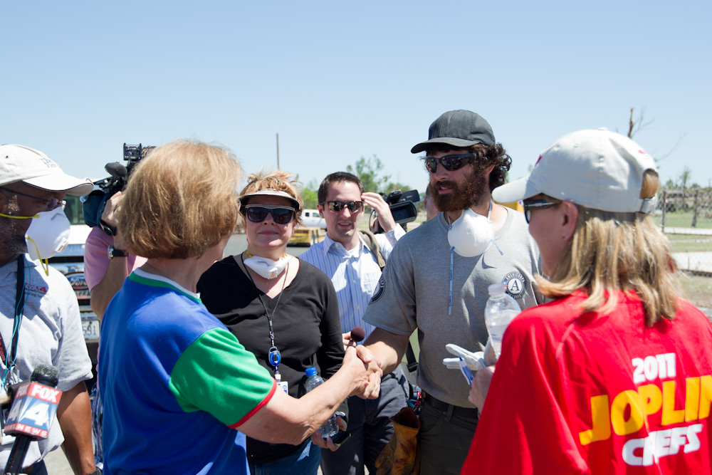 An AmeriCorps member meets with a member of the Kansas City Chiefs family. (Photo by Scott Julian, 2011)