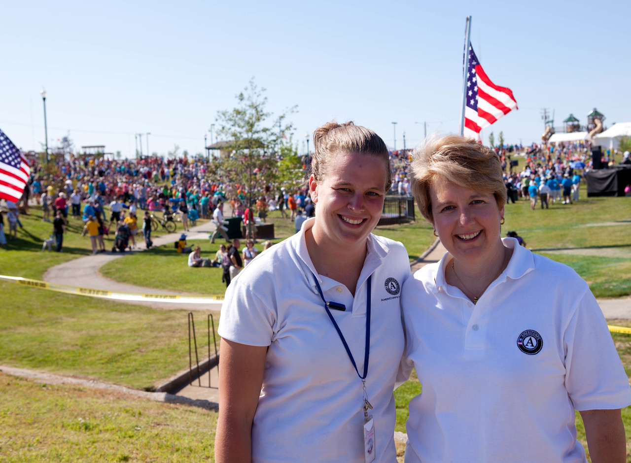 St. Louis AmeriCorps member, Quinn Gardner and Corporation for National and Community Service CEO, Wendy Spencer at Cunningham Park in Joplin, MO. Corporation for National and Community Service Photo
