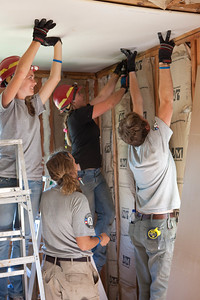AmeriCorps members repairing Jeanie and Warner George's house which was devastated by the tornado in Joplin, MO. Corporation for National and Community Service Photo