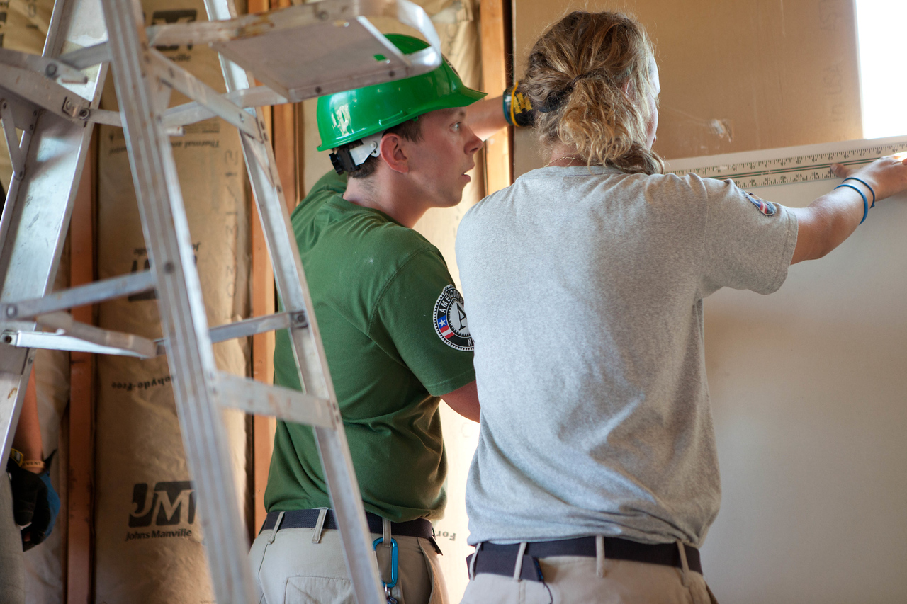 AmeriCorps members cutting dry wall to be placed in Jeanie and Warner George's house which was devastated by the tornado in Joplin, MO. Corporation for National and Community Service Photo