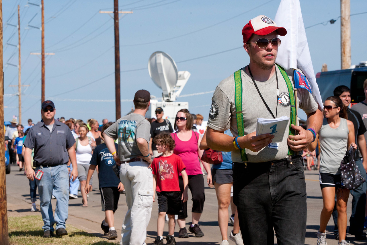 AmeriCorps member along the parade route of the May 22 Walk of Unity in Joplin, MO, marking the one-year anniversary of the 2011 tornado. Corporation for National and Community Service Photo