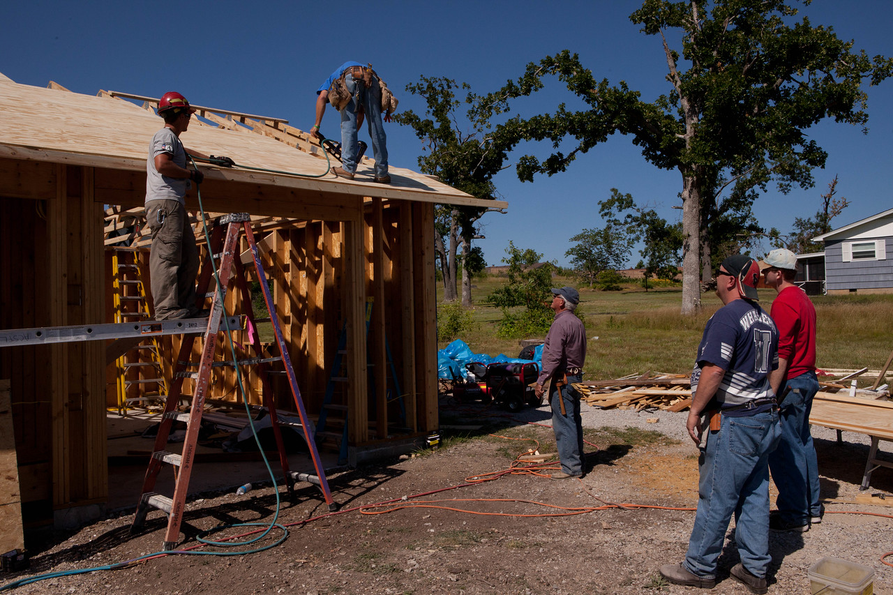 AmeriCorps member and volunteers repairing Jeanie and Warner George's house which was devastated by the tornado in Joplin, MO. Corporation for National and Community Service Photo