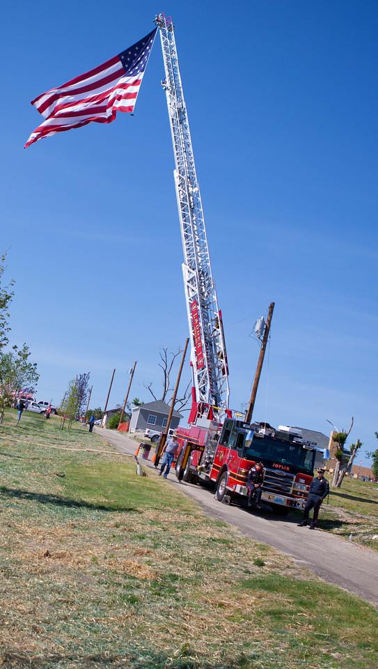 Joplin Fire Department truck raises the American flag, Joplin, MO. Corporation for National and Community Service Photo