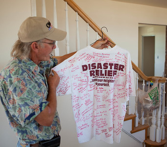 Dan Farren displays a tee shirt signed by the volunteers and AmeriCorps members who are helping rebuild his home after the May 21 tornado that struck the town in 2011. Corporation for National and Community Service Photo